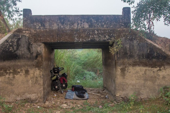Illegal Wild Camping under a tunnel in Myanmar on my bike tour cycling around the world.