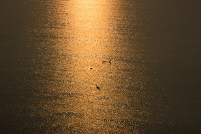 Fishermen over Inle Lake at sunrise in Myanmar from a hot air balloon.