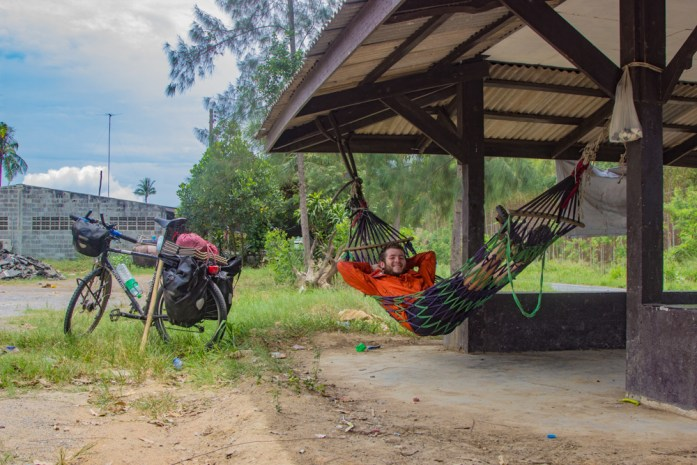Relaxing in a hammock after a long day bike touring in Thailand. BIke is propped up beside me.