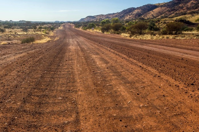 Corrugated, bumpy, unsealed dirt road in Australian Outback
