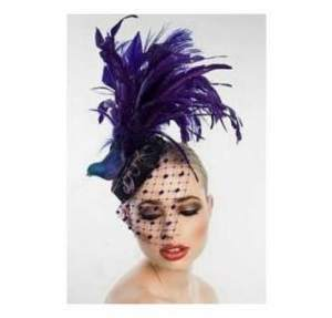 Cheri Camp Potter's authentic Kentucky Derby purple hat is inspired by Prince.