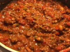 Add the tomato sauce, diced tomatoes, and green chilies