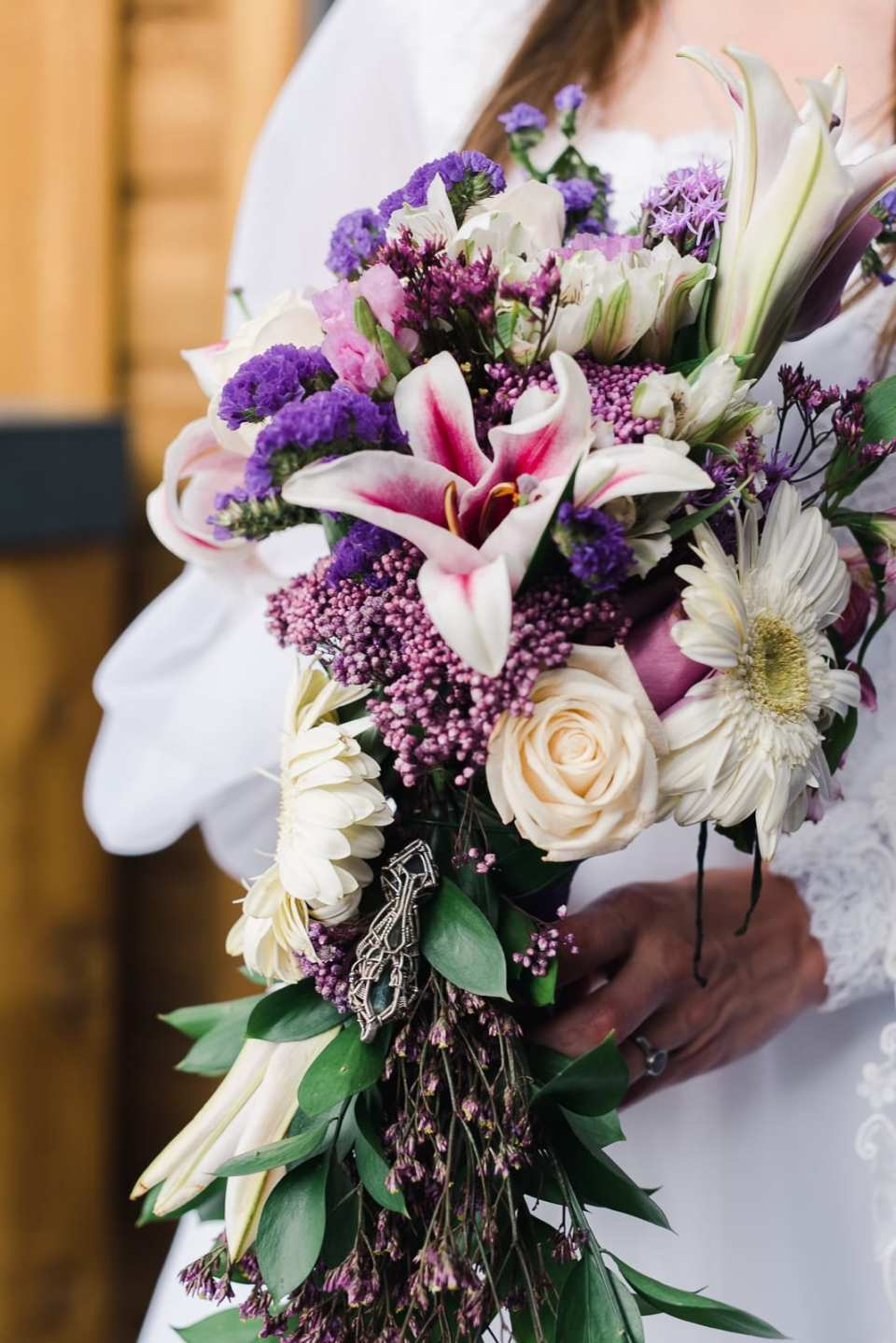 Hippie styled wedding bouquet with wrapped crystal by Josie V Photography