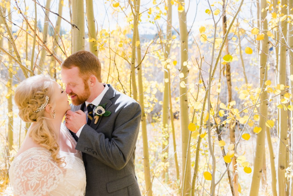 Couple among Fall aspen trees in Colorado Wedding | Josie V Photography