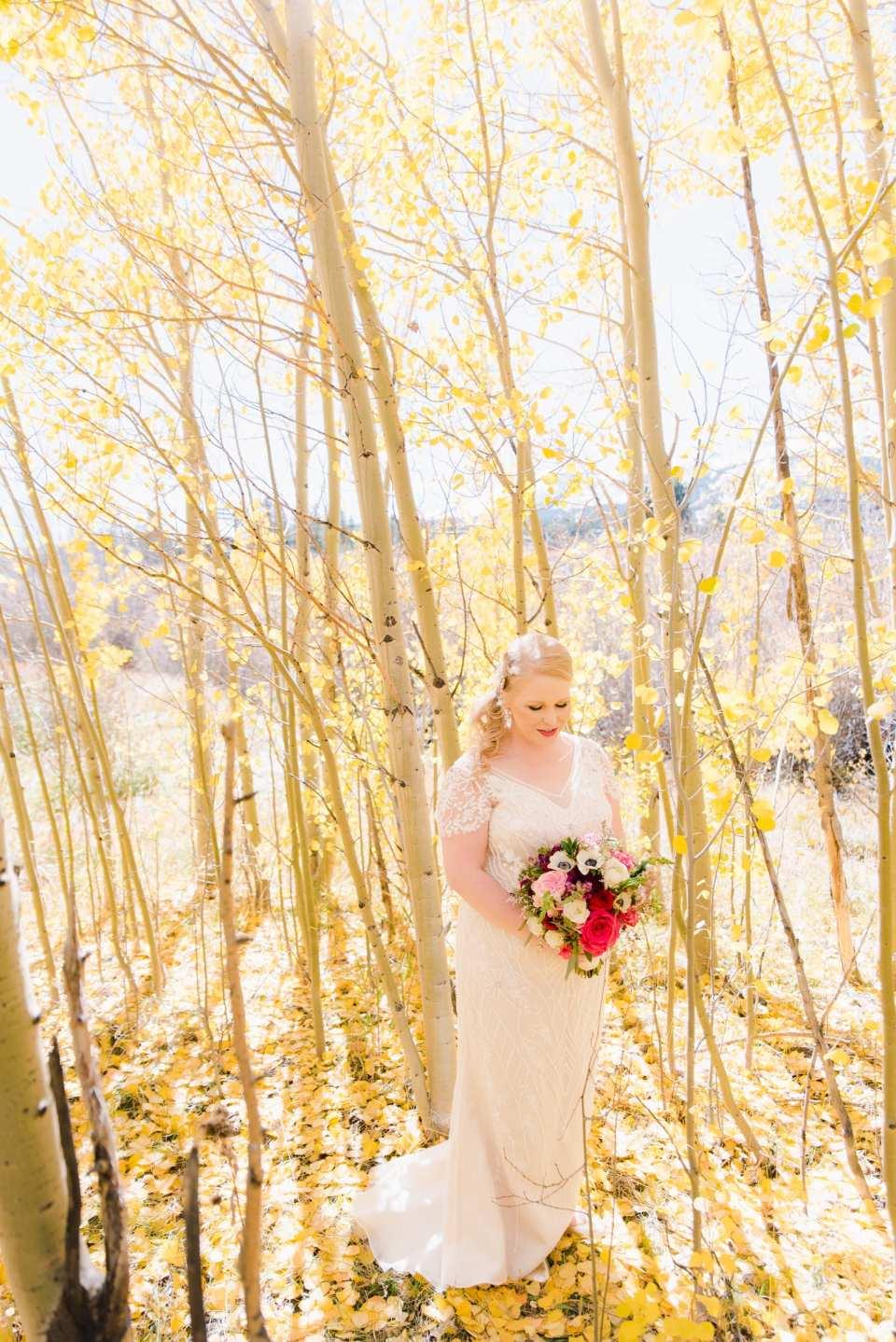 Bride in Aspen Trees in Fall Colorado Wedding | Josie V Photography
