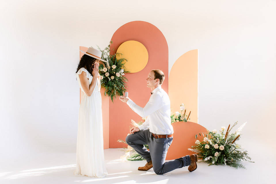 You've just gotten engaged, how do you decide between an elopement vs. wedding? This photo shows a Denver Studio Engagement, at Realm Denver. Engagements are where the wedding planning starts, here is how to decide what ceremony is best for you!