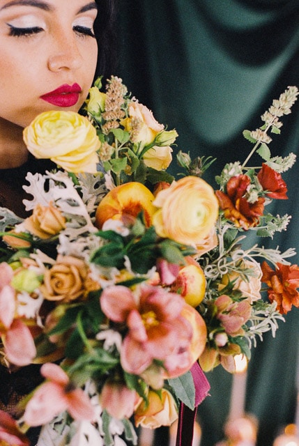 Unique bridal bouquet with peaches photographed on Porta 400 film. This modern bouquet is full of wedding inspiration for the creative bride. Bright and lush wedding film photography.