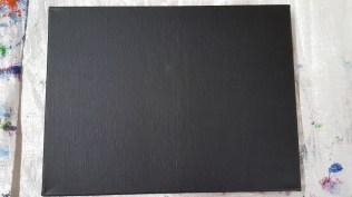 Black paint over canvas