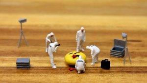 Miniature team of crime scene specialists