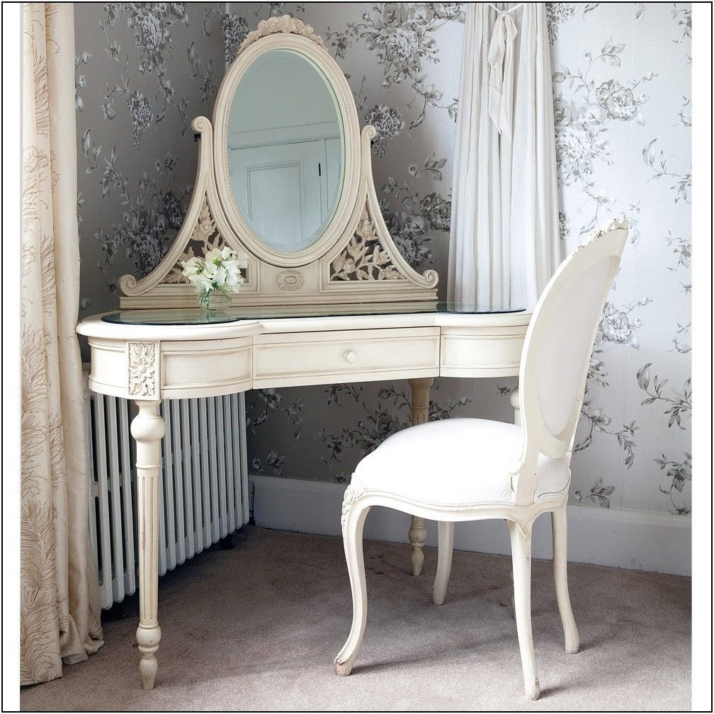Best Distressed Wooden Corner Vanity Table For Bedroom In White Finish With Oval Mirror Having Carved With Pictures