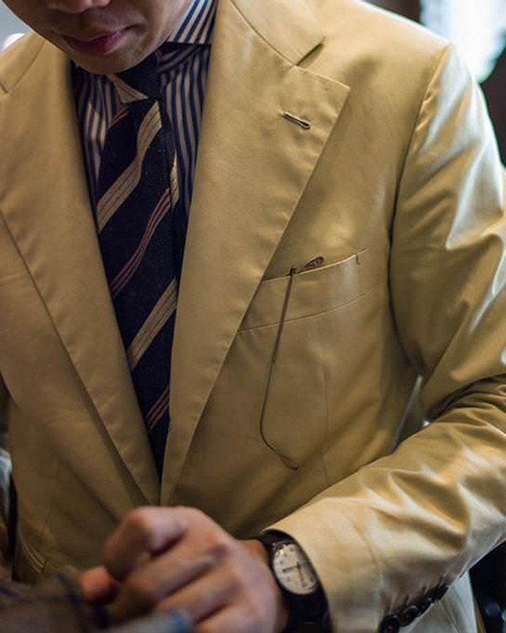Bold striped tie on bengal shirt.