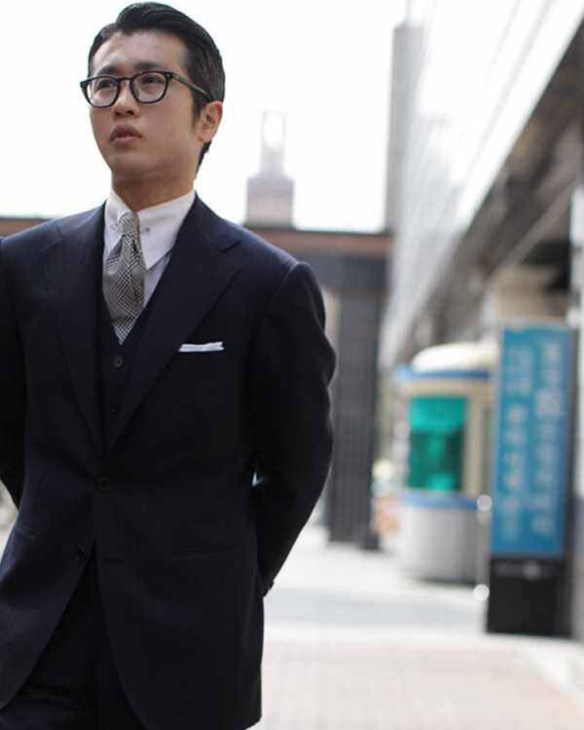Chad Park in thick frames, classic 3PC DB, and vintage flair with a pinned point collar.