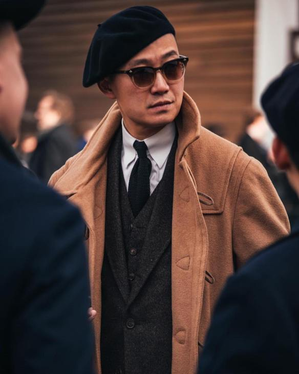 Black beret and knit tie on Kenji.