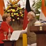 NEW DELHI, INDIA – NOVEMBER 1: Prime Minister Narendra Modi greets German Chancellor Angela Merkel during their joint p