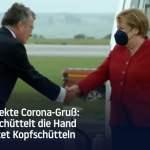 Merkel schüttel die Hand während der Bundestag die Epidemie-Notlage willkürlich verlängert; Bild: Startbild Youtube RT DE