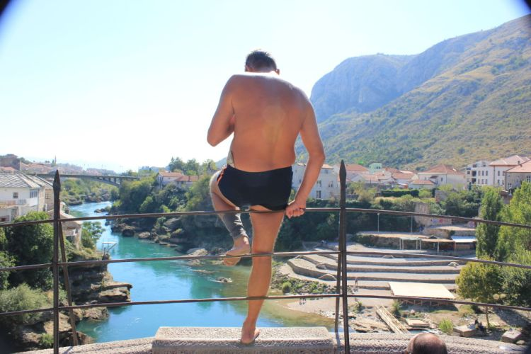 locals jumping off the bridge in Mostar