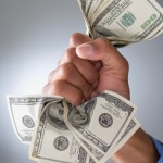 Mixed Race businessman holding money_web