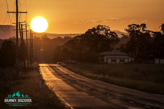 Sunset over a road heading out of ipswich