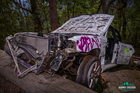 A crashed and trashed car in Mt Mee, D'Aguilar National Park, Queensland, Australia