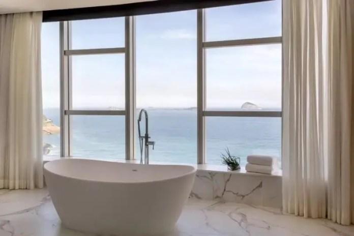 A freestanding bath overlooking the ocean inside the Nacional