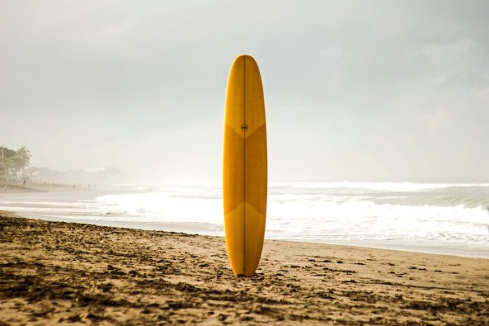 surf board in sand