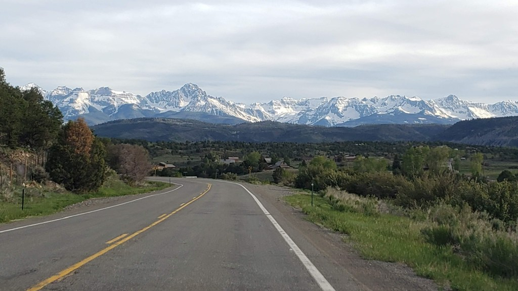Winding roads leading to snowcapped mountains in Colorado