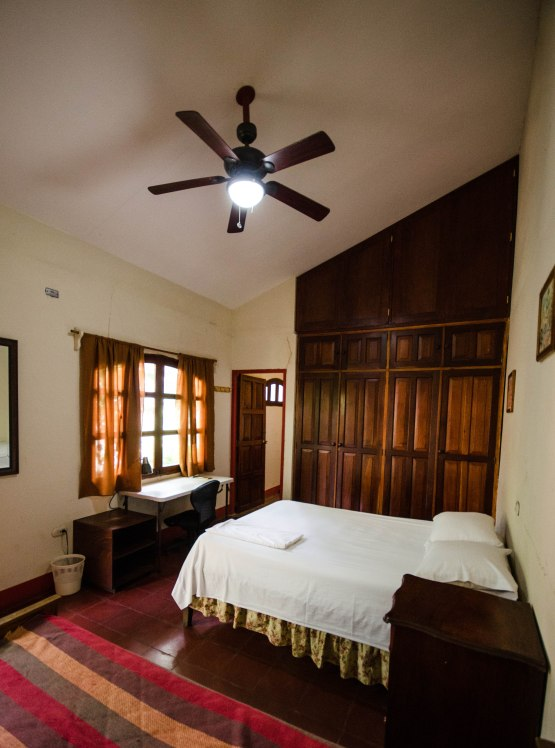 Room 1 w/ shared in-room bathroom, spacious closet, desk, ,ceiling fan, comfortable matrimonial bed. Price: 1 person $ 17 per night 2 persons $ 25 per night
