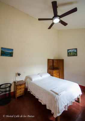 Room 2 w/ shared in-room bathroom, spacious closet, desk, ceiling fan, comfortable matrimonial bed. Price: 1 person $ 17 per night 2 persons $ 25 per night