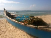 A non-murder's boat on Malpe Beach, with St Mary's Island in the background.