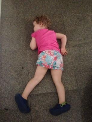 Sleeping in the hallway.