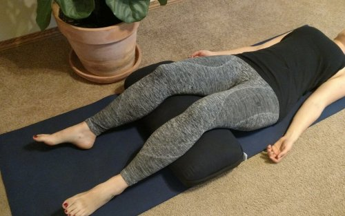 Using yoga bolsters for a savasana prop
