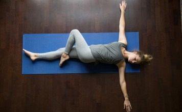 Reclining Twist: Lie on your back, bending one leg and bringing your knee across your body. Try to keep both shoulders on the ground.