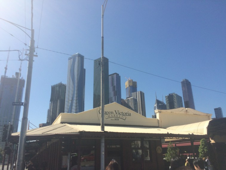 queen victoria markets, melbourne with skyscrapers in the background