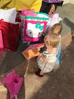 Peeking in her presents.