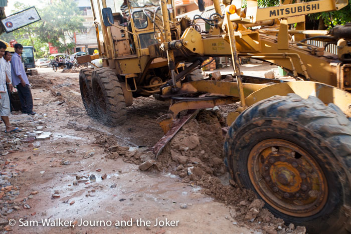 Grader doing roadworks, Siem Reap