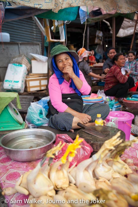 Selling chicken at Psar Leu Market