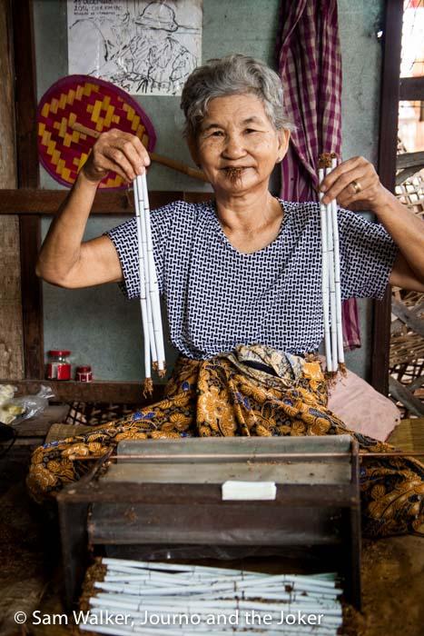 Old lady in Battambang hand makes cigarettes