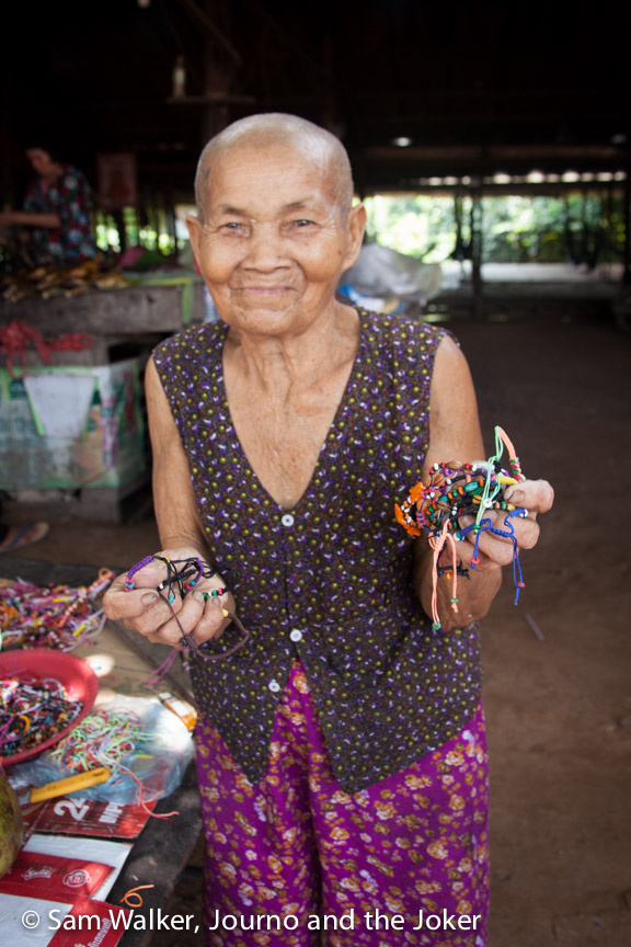 A Cambodian granny selling bracelets
