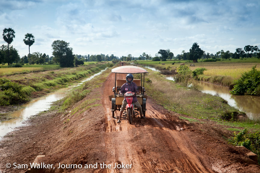 Marom Hem takes the tuk tuk on muddy roads