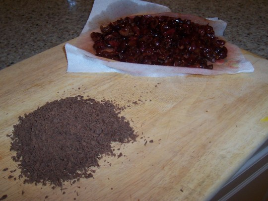 Add the chopped cheries, grated chocolate and Amaretto.