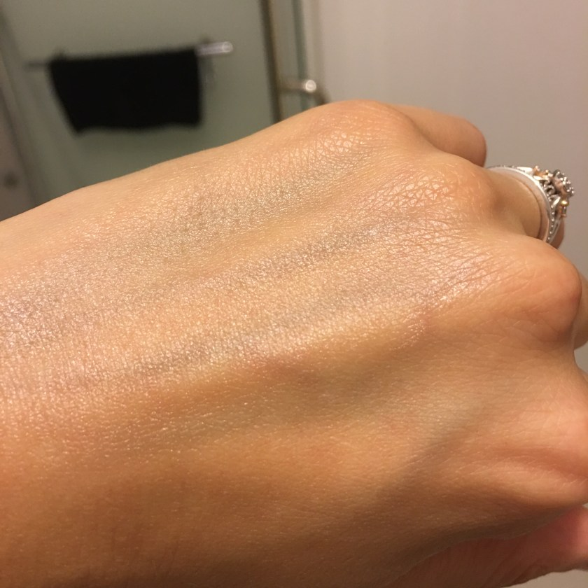 Lush Million Dollar Moisturiser switched on hand