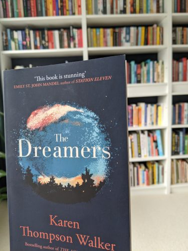 Cover of The Dreamers with a bookshelf in the background