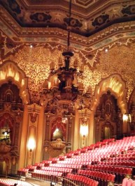 Taking down the chandelier at the Ohio Theater for cleaning.