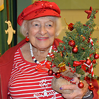 Woman holding decorated tree