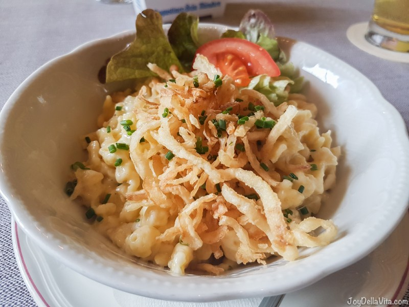 small portion allgaeuer kaesspatzn with a small side salad - Forelle Dorschhausen traditional Restaurant Bavaria JoyDellaVita