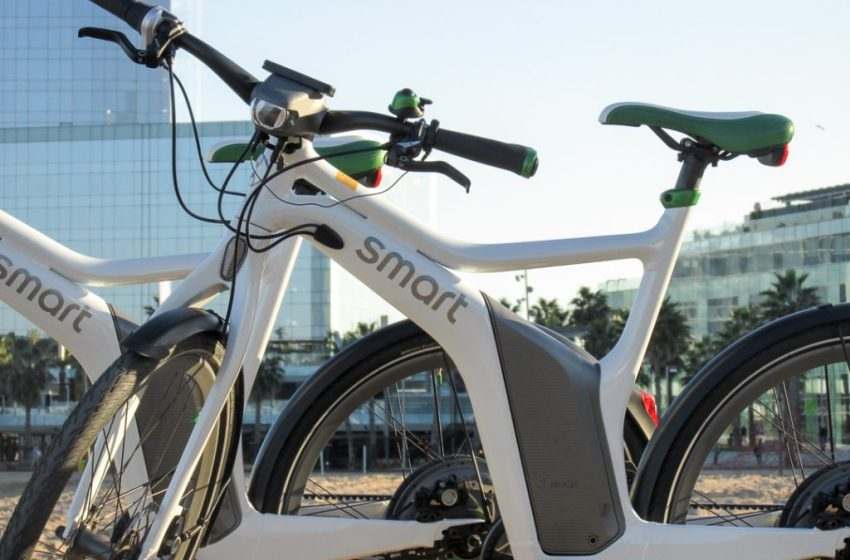 Riding the smart eBike along the Beach in Barcelona