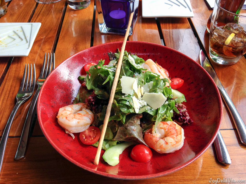 """Salad """"Rizzi"""" - Seasonal summer salads with French dressing, grilled scampi and datterino tomatoes with parmesan cheese cracks on top"""