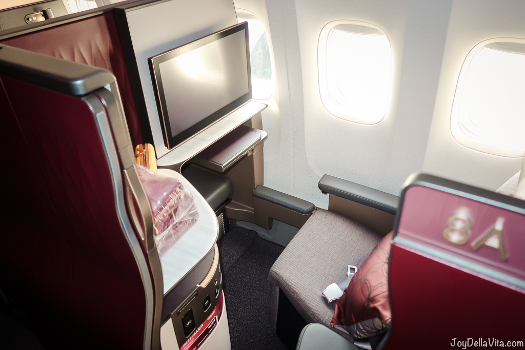 Experience Qatar Airways Qsuite Business Class Flight Window Seat 8A rear facing