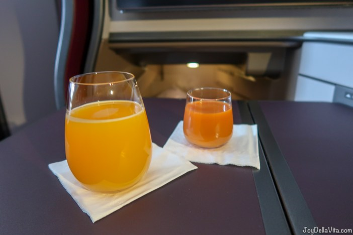 Fresh Orange Juice and Energizer Shot with ginger Qatar Airways Qsuite Business Class