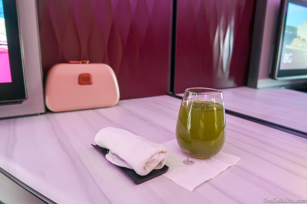 Refreshments right after boarding, still before take off, cold towel and a lime mint refresher non-alcoholic drink Qatar Airways Qsuite Business Class